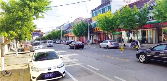 市城区南关路80%商铺主自拆违建为全市树榜样